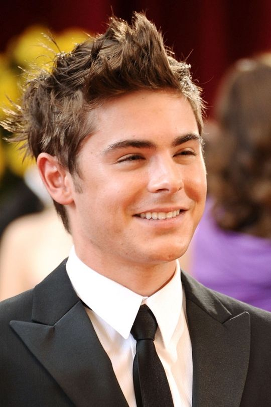 Zac Efron Long Hair | ... hair with some crazy spikes in it. He uses some kind of hair gel to
