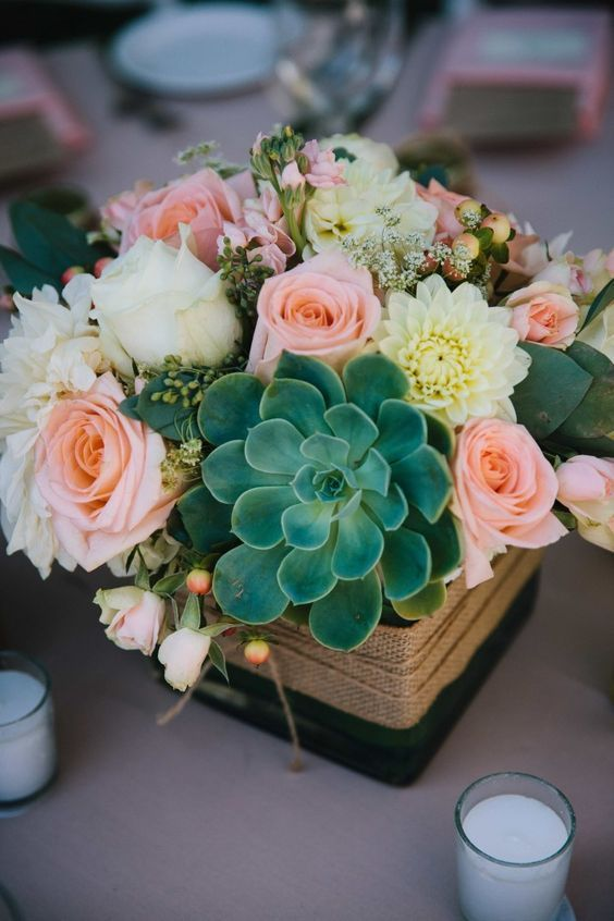 rustic pink roses wedding centerpiece idea via Elle Jae Photography / http://www.deerpearlflowers.com/rustic-wedding-details-and-ideas/