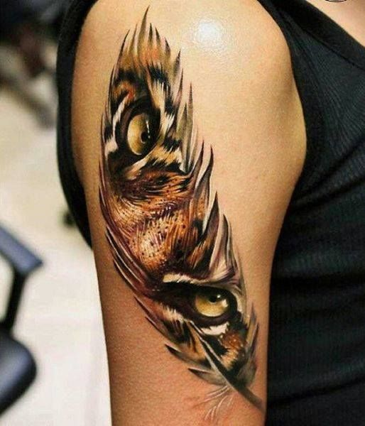 Feather with tiger eyes tattoo