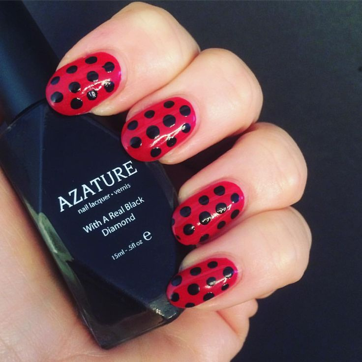 Love these classy ladybug nails.