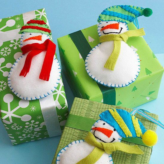 Use felt scraps in a variety of colors to make fun felt snowmen to use as Christmas ornaments or decorations./: