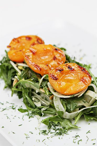 Fennel and arugula salad with grilled apricots and Marcona almonds. Delicious!