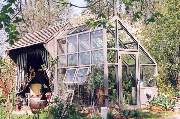 Modern Glass Greenhouse via Solar Innovations.