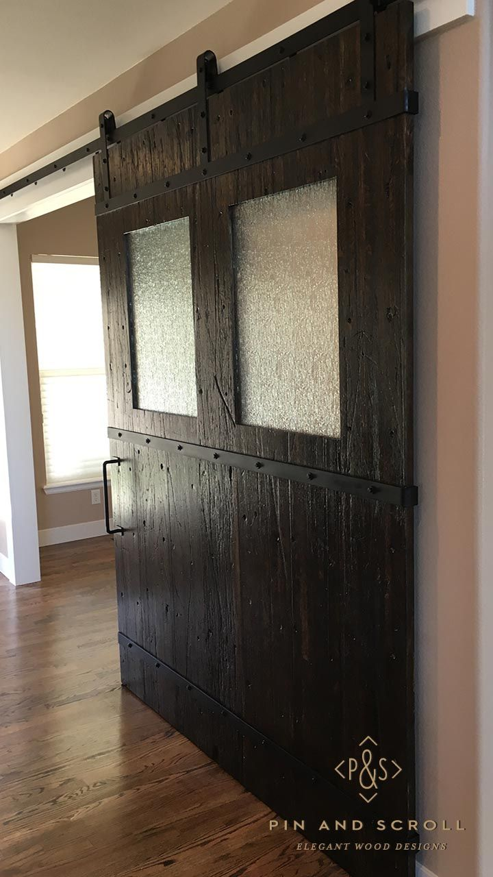 Stone fireplace with reclaimed bargeboard finish contemporary - Barn Door Made From Reclaimed Boxcar Flooring With Steel Bands