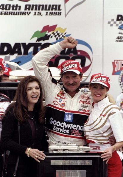 DAYTONA BEACH - FEBRUARY 15: Dale Earnhardt Sr. driver of the #3 GM Goodwrench Chevrolet and wife Teresa celebrate victory with the trophy after the Nascar Daytona 500 on February 15, 1998 at the Daytona International Speedway in Daytona Beach, Florida. (Photo by David Taylor/Getty Images)