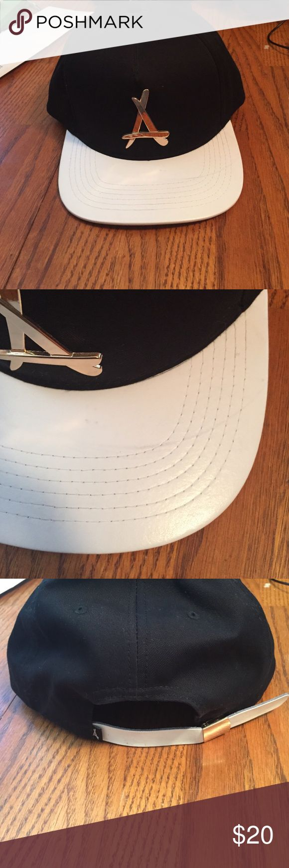 Tha Alumni strapback hat Black strapback with gold A letter on front with a faux leather bill. Worn only once. Has a mark on the bill. Tha Alumni Accessories Hats
