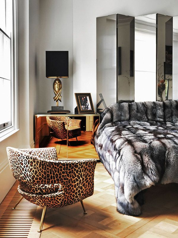 A leopard armchair in the Notting Hill townhome of designer Colin Radcliffe and wife Angela Dunn.