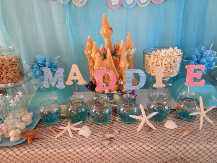 Mermaids baby shower themes and mermaid baby showers on for Ariel birthday party decoration ideas