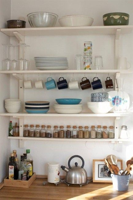 Open shelving takes up less visual space. Edit the things you don't need, screw hooks on the underside of a shelf to store cups, add a narrow shelf for storing spices.