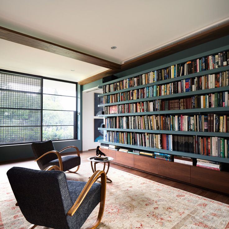 [Project: Harbour Front Row Seat] 1930s Halabala reading chairs contemplate the light filled library   © Justin Alexander