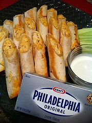 """Taquitos """"This recipe is a keeper."""" 4 cup(s) of chicken, cooked and shredded 12 soft taco, flour tortillas 2 cup(s) of mozzarella cheese, grated 4 ounce(s) of Philadelphia cream cheese 1/3 cup(s) of Frank's hot sauce 1/3 cup(s) of milk 2 tbsp. of butter 1 tsp. of Mrs. Dash 1 tsp. of garlic powder 2 tbsp. of vegetable oil"""