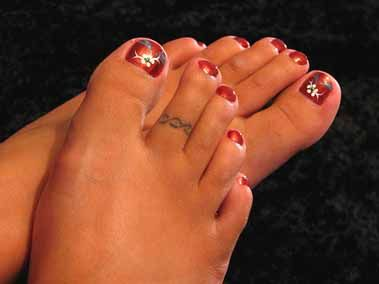 The tattoo artist I spoke with said a toe ring tattoo is a bad idea (the results don't last). Good idea, but I believe these results would be a MISS.