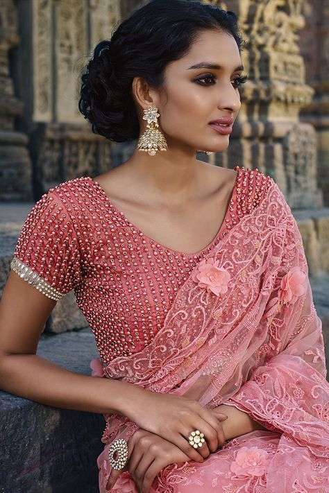 i just love this blouse absolutely....even a plain saree would go so beautifully with this blouse