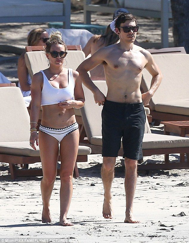 Nice looking pair: Sporting coordinating black and white bathing suits, the pair looked go...