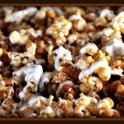 ... popcorn loaded with Salted Nuts and drizzled with warm White Chocolate