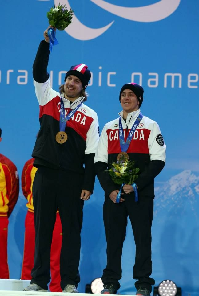 Sochi, Russia, 08/03/2014. Canadian skier Mac Marcoux and guide Robin Femy celebrate their Bronze medal win at the Sochi 2014 Paralympic Winter Games in Sochi Russia. Photo(Scott Grant/Canadian Paralympic Committee)