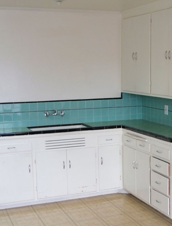 Omg- this is what my tile looks like under the hideous white speckled spray on counter someone coated it with. So tempted to attempt a renovation.   Cute Turquoise and black Tile in an original 1940s kitchen. I have the same faucet.