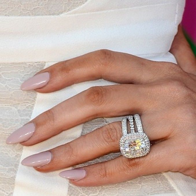 Khloe Kardashian's engagement ring reset with halos of diamonds around the center stone LOVE the wedding bands!!