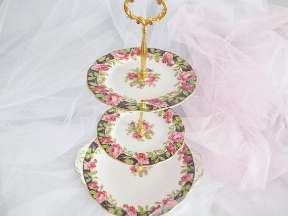 A 3- tier Queen Anne Black Majic cake stand. English fine bone china perfect for afternoon teas, luncheons and bridal parties. Beautiful