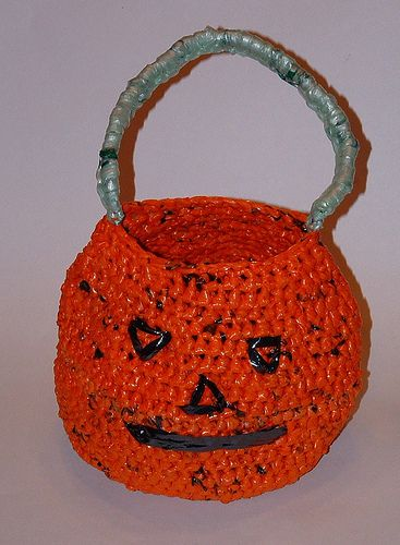 Plarn Halloween Bag -Halloween is just around the corner and I've been saving plastic orange newspaper bags for quite awhile so I could crochet a recycled trick or treat bag. I just got it finished in time and am here to share the project with everyone.This trick or treat bag features a milk jug base so its nice and sturdy