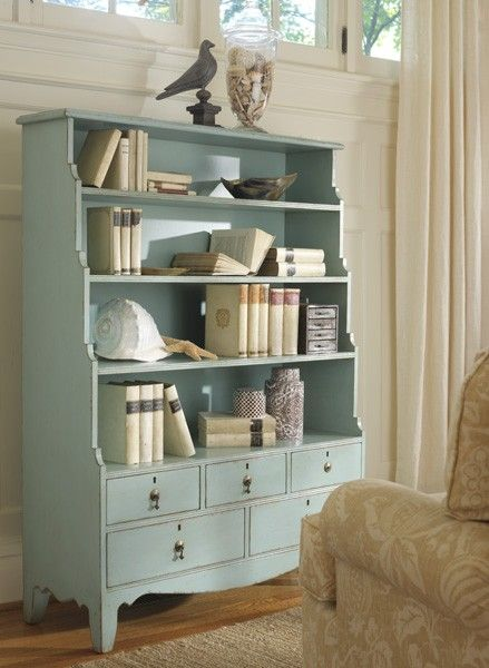 This lovely bookcase features three shelves on the top and drawer space on the bottom. Great for displaying books treasures and extra storage space. The bookcase measures 44