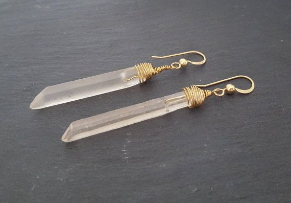 Long beveled CRYSTAL QUARTZ bars are generously wrapped in 14k gold filled wire and hang from gold filled earring hooks. So Dramatic & Eye Catching! The perfect statement earring. The Crystals are opa                                                                                                                                                      More