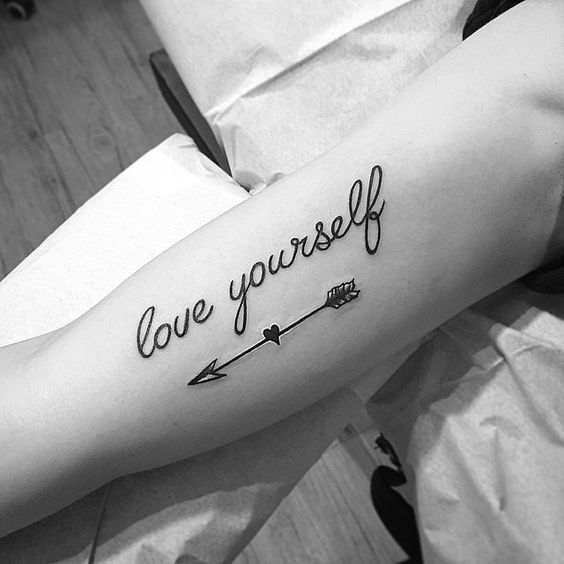 This arrow tattoo is a little bit different because the arrow actually has a heart in the middle. The heart and the arrow wouldn't normally go together but end up looking great. Then there's the quote above that can obviously be customized to whatever you'd like.