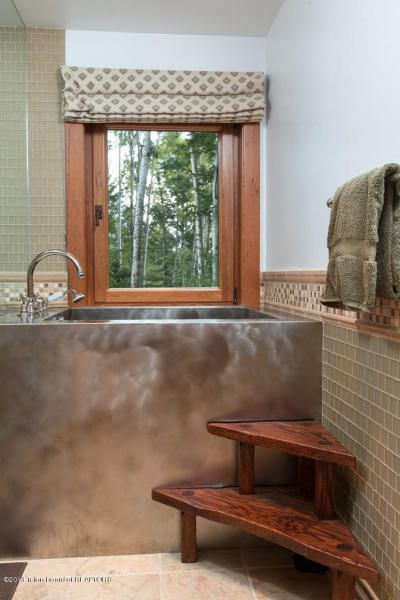 metal bathtub in Christy Walton's former Wyoming estate.  I love the metal tub but those steps into the tub look dangerous.  no handrail etc.