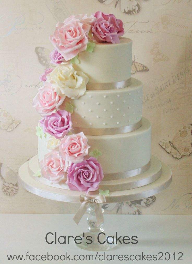 3 tier wedding cake with cascading roses ivory wedding cake with pink lilac and ivory roses 10341