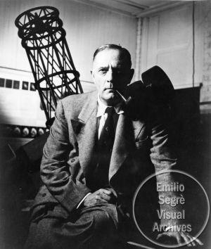 Portrait of Edwin Hubble sitting in front of the Hooker ...