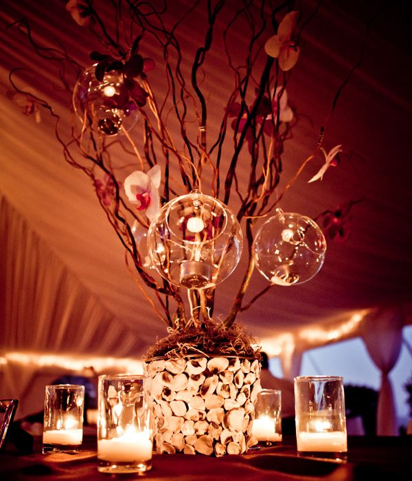 Gorgeous tall centerpieces floating candles and