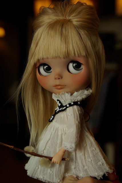 Adorable blonde Blythe in white dress.