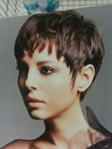 Nice and Lovely Pixie Cut with Cool Layers and Charming Bangs and Cute Messy Arrangement ... I do love this cut and the warm colour. Could also be spiked and ruffled up a bit for some variety : )