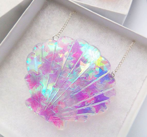 An enchantingly beautiful resin Sea Shell statement necklace, carefully filled with iridescent stars, a must have for all magical mermaids! The