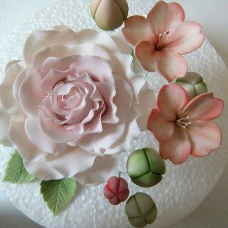 Beautiful sugar paste flowers from Sweet As Sugar. Love that rose