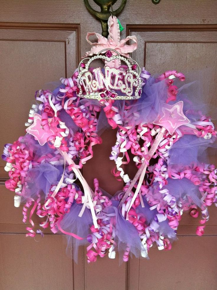 Door wreath for princess party we made...I may add rhinestones to the tulle.  Made using a cake cardboard that we painted and just cut a hole in the middle, premade curly ribbon bundles from the dollar tree, and tulle to fill in the spaces.  :)