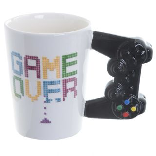 Game Controller Shaped Handle Ceramic Mug.  Dimensions: Height 11cm Width 14.5cm Depth 8.5cm  Delivery prices available on Checkout