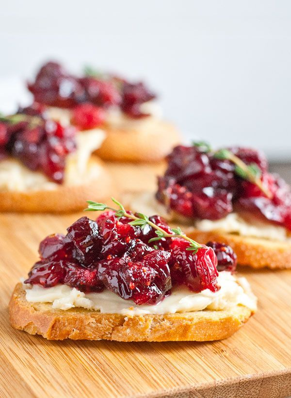 Roasted Balsamic Cranberry and Brie Crostini. Festive, colorful holiday party appetizer recipe.