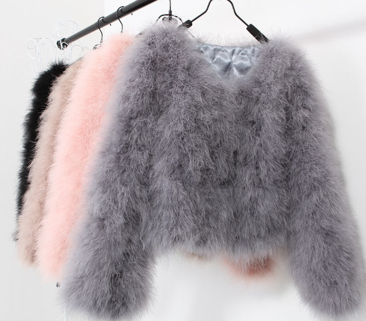 Short hip length ostrich feather coat Hand made ethically sourced ostriches feathered jackets. Available in all colours Black,Navy,Grey,White,Pale pink,Tan,Wine red 55cm in length These are