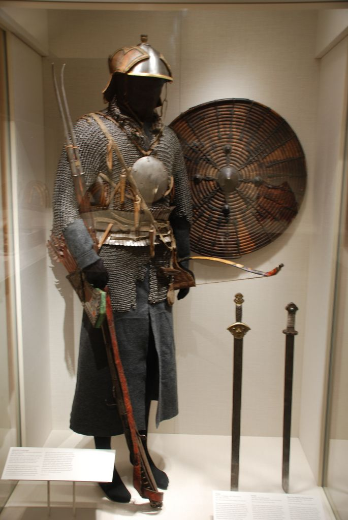 Tibetan cavalry armor, 18th to 19th century, possible Bhutanese and Nepalese elements, iron, gold, copper alloy, wood, leather, and textile, assembled based on photographs taken in the 1930s and 1940s in the Tibetan capital of Lhasa during the Great Prayer Festival. The photographs showed troops of ceremonial armored cavalry, who wore a standardized set of equipment as stipulated by the central government of Tibet probably from the mid-seventeenth or eighteenth century onward. Met museum.
