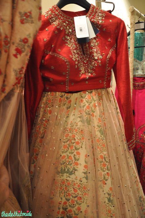 Anju Modi red blouse floral print lehenga with sheer layer