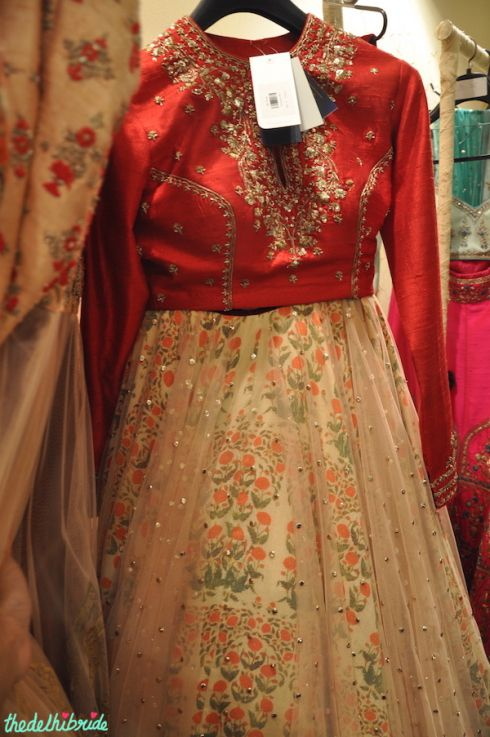 Anju Modi red blouse floral print lehenga with sheer layer