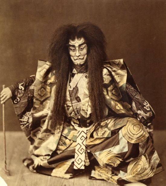 photo of Japanese Kabuki performer in full costume and makeup, Date: ca. 1870, Albumen print with applied color, Peabody Museum