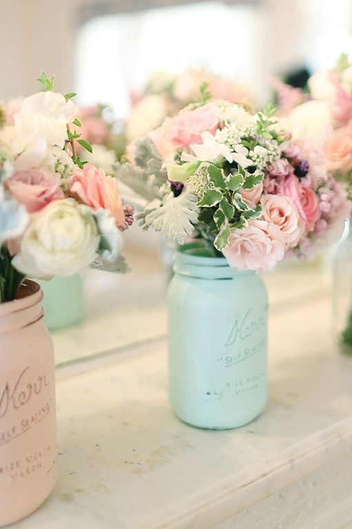 http://www.wedpics.com/blog/thrifty-diy-wedding-decorating-ideas-we-love/  painted distressed mason jars