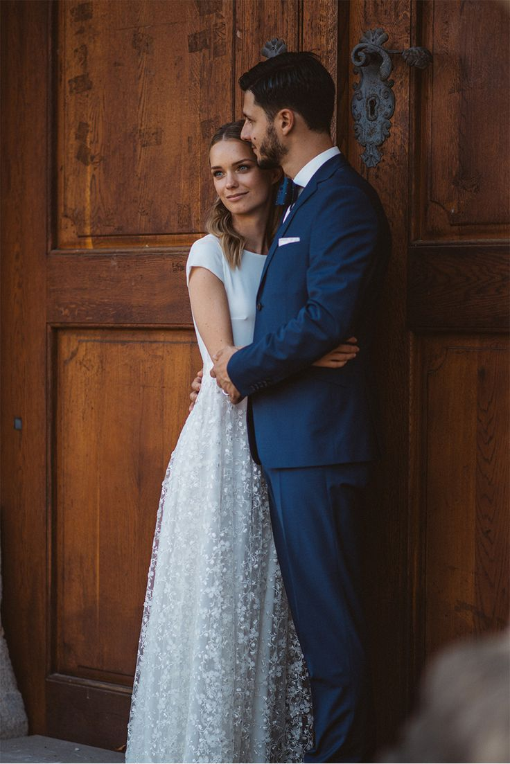 I love this wedding photo of the bride and groom in front of big old doors. Very rustic and mystical. Bride's beautiful dress was designed by eNVy Room .