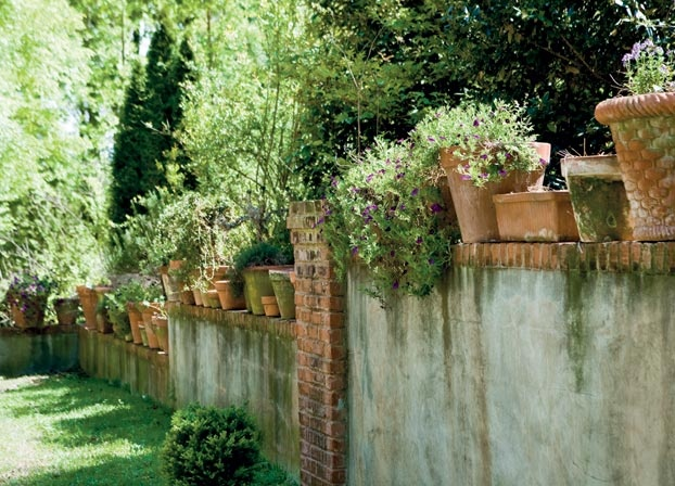 Terra Cotta Pots On A Wall