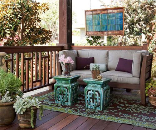 Create An Outdoor Porch Retreat   I Love The Idea Of Hanging Art Around The  Patio Or Garden. I Also Love The Ceramic Stools Used In Place Of An Ottoman.