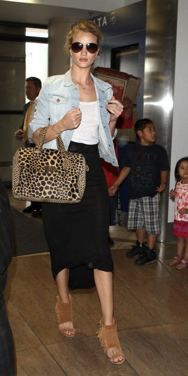 Rose Huntington-Whiteley carries a Mulberry Del Rey Animal Print Bag at the airport in Los Angeles