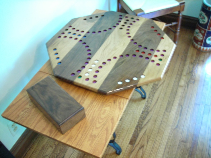 4 person and 6 person Custom Marble Game Board in hardwood striped design with marbles cards and custom box for game pieces. Box is dovetail construction.