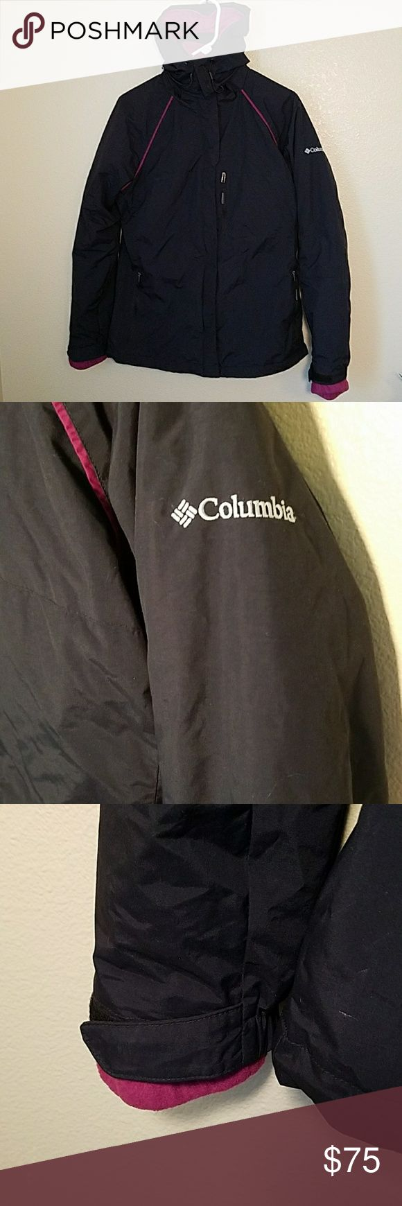 Columbia black and magenta ski coat interchange m This Columbia jacket is in excellent condition. It is a two in one ski coat. Black outer shell is fully lined with magenta color. Two pockets for hands and one zip pocket 4 small valuables. Inner lining of fleece jacket that comes out and can be a stand-in loan Columbia fleece. Beautiful color. Hood is fully removable from coat. Size medium. Columbia Jackets & Coats